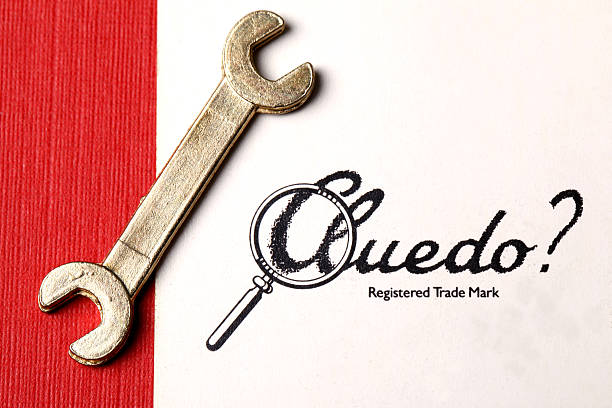 cluedo card and spanner - murder mystery stock photos and pictures