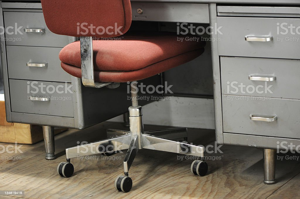 Clunky Office Chair and Desk stock photo
