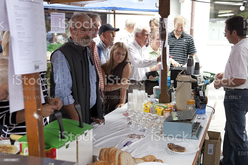 Cluster of Customers at Bratwurst Stand, Saanen Brocante royalty-free stock photo