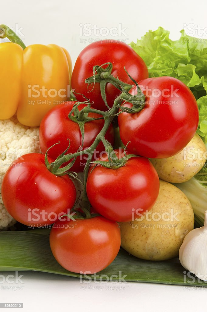 Cluster of ripe tomatoes on vegetable background royalty-free stock photo