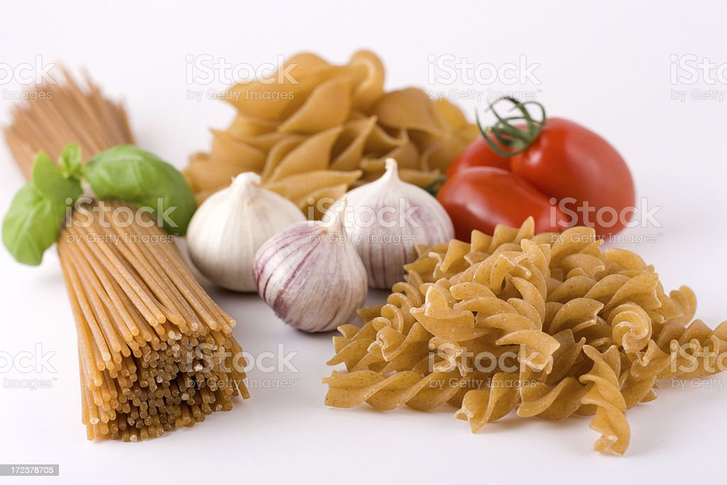 Clusters of different whole grain pastas with vegetables royalty-free stock photo