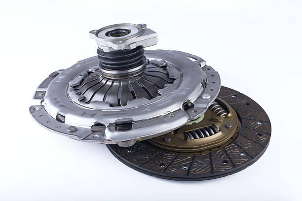 Clutch disc kit car on a white background Clutch disc, clutch cover and bearing for car on a white background vehicle clutch stock pictures, royalty-free photos & images