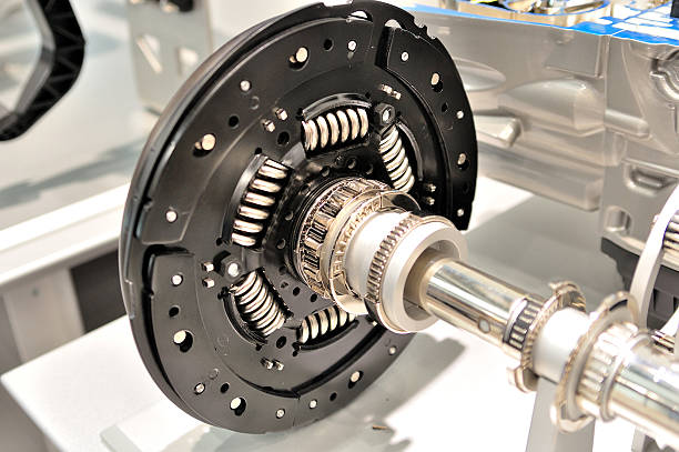Clutch plate. Clutch plate on an axle with bearing. vehicle clutch stock pictures, royalty-free photos & images