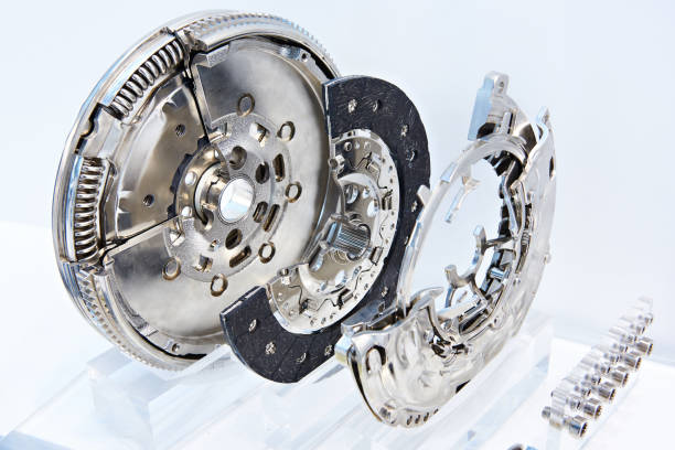 Clutch system with dual mass flywheel Clutch system with dual mass flywheel, pressure plate and concentric slave cylinder vehicle clutch stock pictures, royalty-free photos & images
