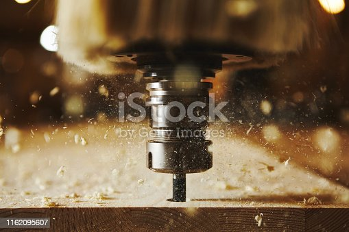 istock Cnc milling machine, woodwork industry. Tool with computer numerical control. 1162095607