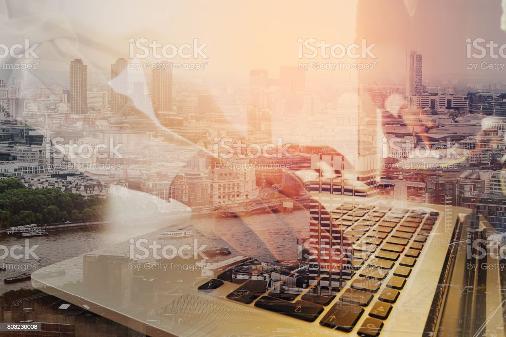 co working team meeting concept,businessman using smart phone and laptop and digital tablet computer in modern office with London city exposure stock photo