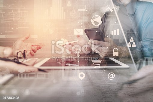 istock co working team meeting concept,businessman using smart phone and laptop and digital tablet computer in modern office with virtual interface icons network diagram 917303408