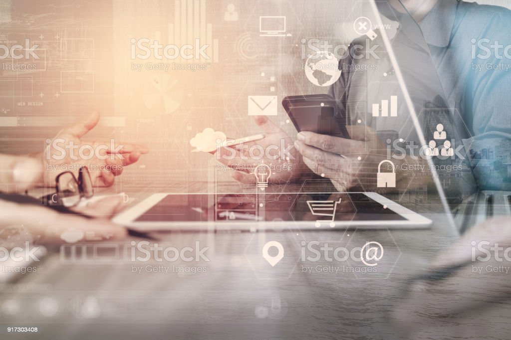 co working team meeting concept,businessman using smart phone and laptop and digital tablet computer in modern office with virtual interface icons network diagram stock photo