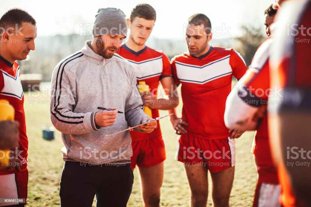 Coach advising his team stock photo
