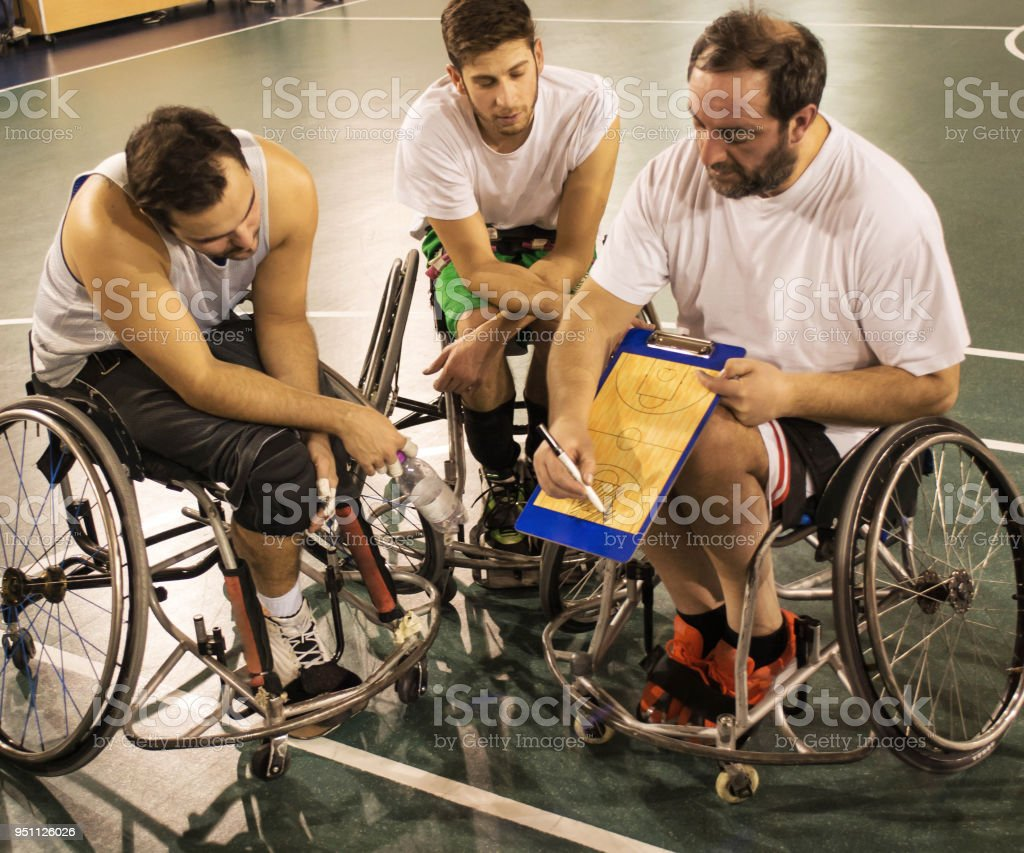 Coach and his Disabled Basketball Player Team