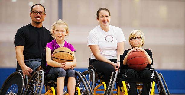 coach and students sitting happily in their wheelchairs - wheelchair sports stock photos and pictures