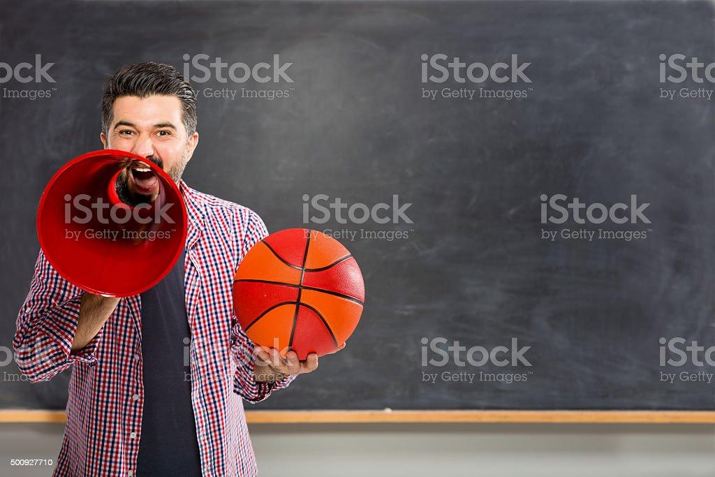 Coach calling on blackboard. stock photo