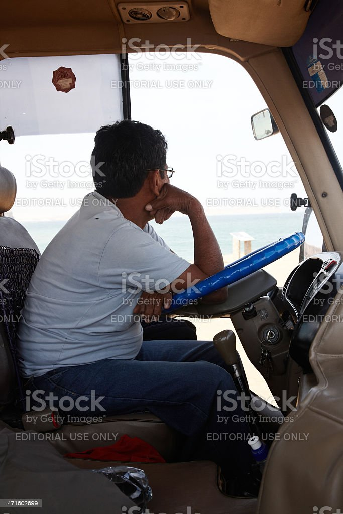 Coach driver at the wheel of his bus royalty-free stock photo
