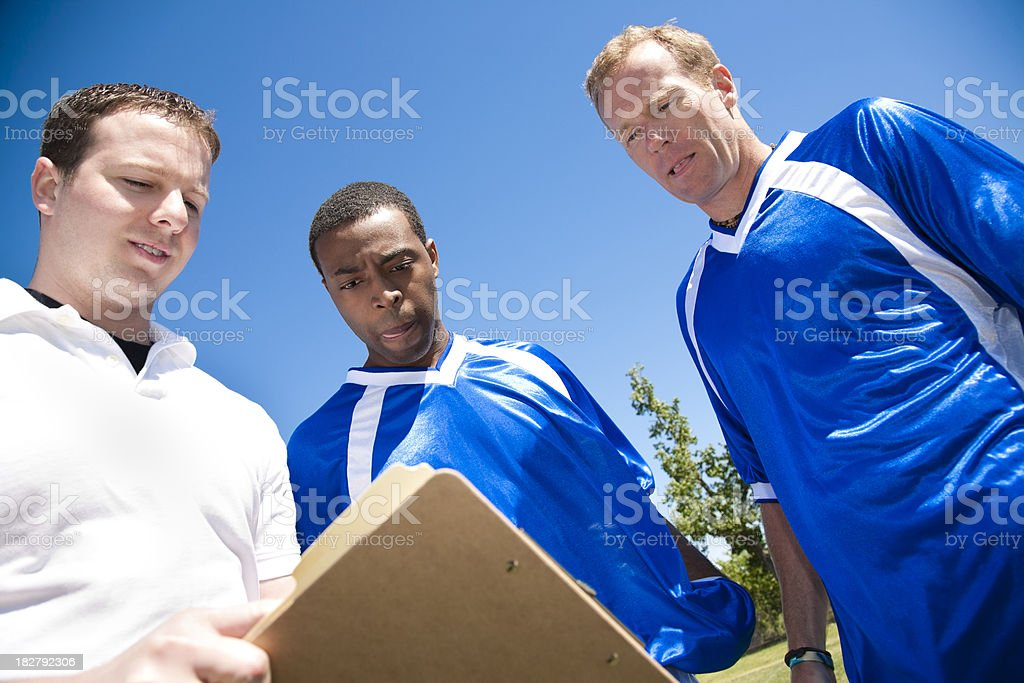 Coach Explaining Play to Soccer Players royalty-free stock photo