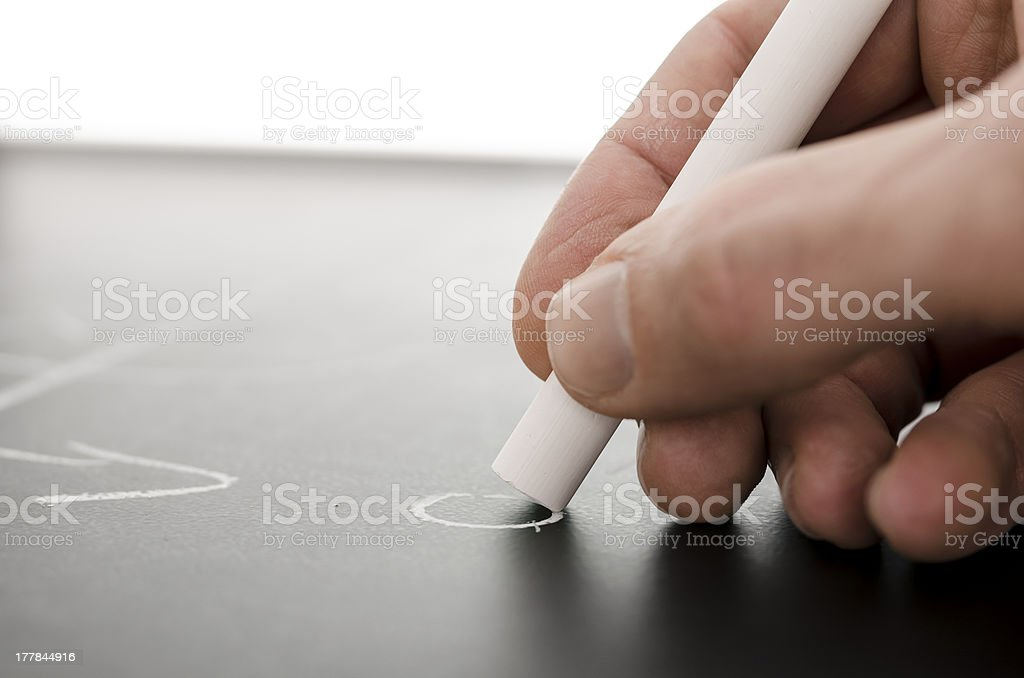 Coach hand writing a football game strategy royalty-free stock photo