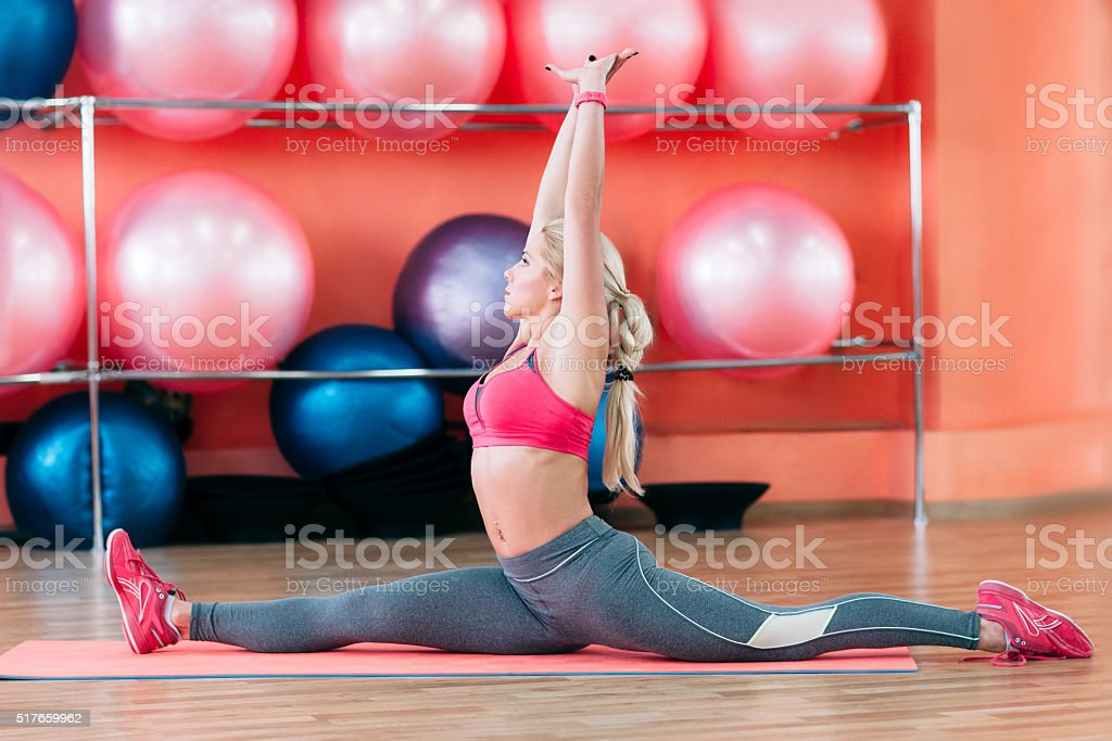 coach in gym showing split stock photo