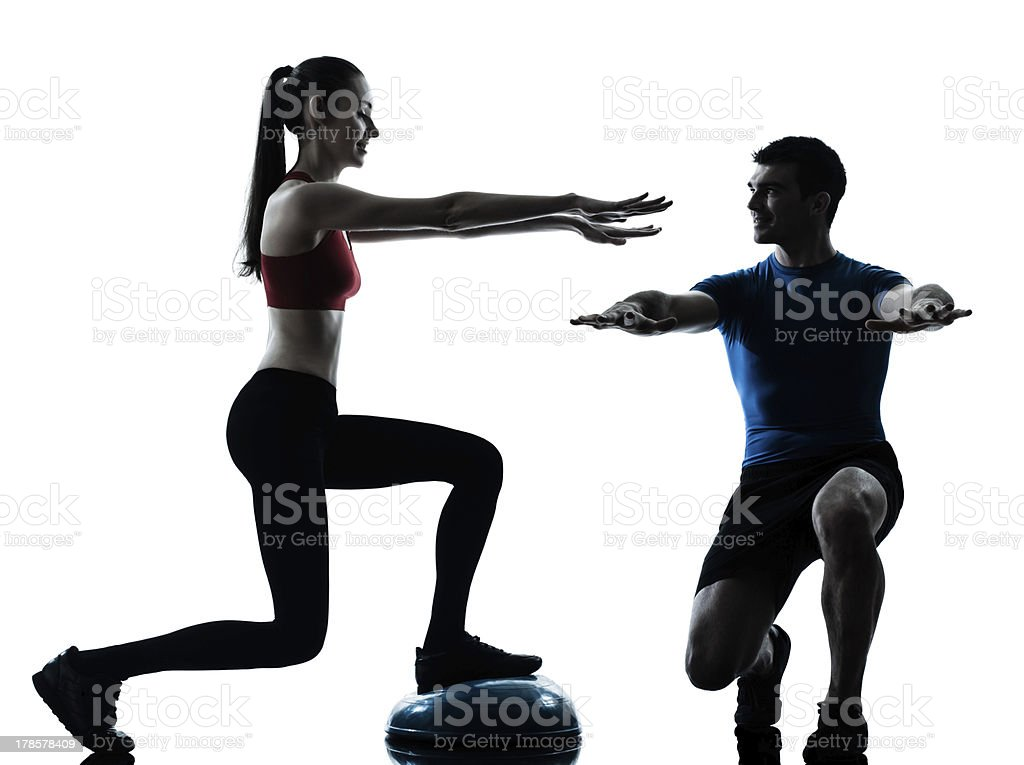 coach man woman exercising squats on bosu royalty-free stock photo
