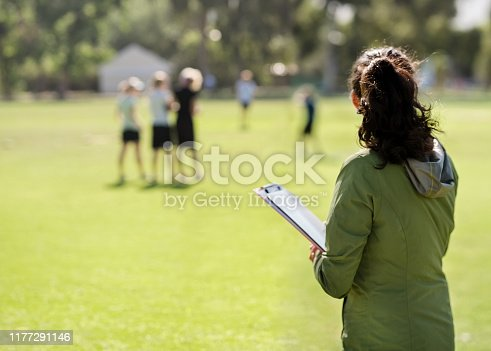 istock Coach monitoring the team practicing 1177291146