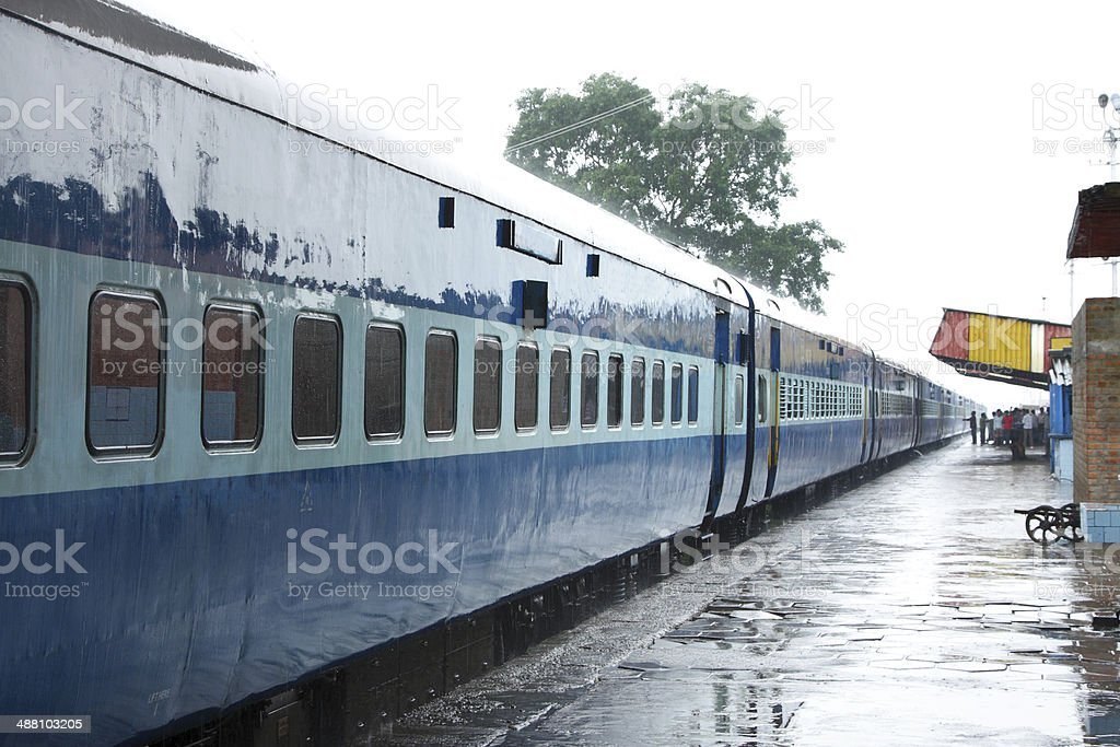 AC coach of Indian train on the station during rain stock photo