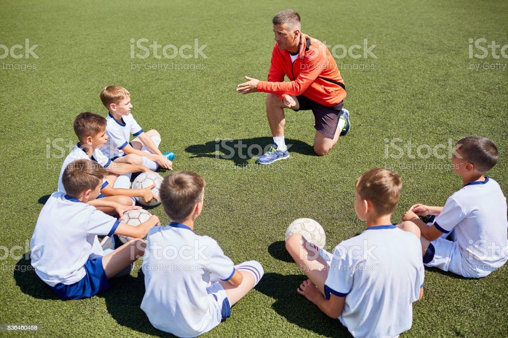 Coach Talking to  Junior Football Team stock photo
