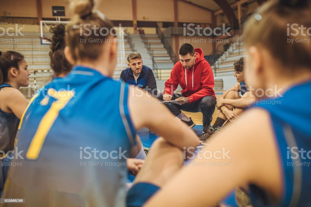 Coach talking to players stock photo