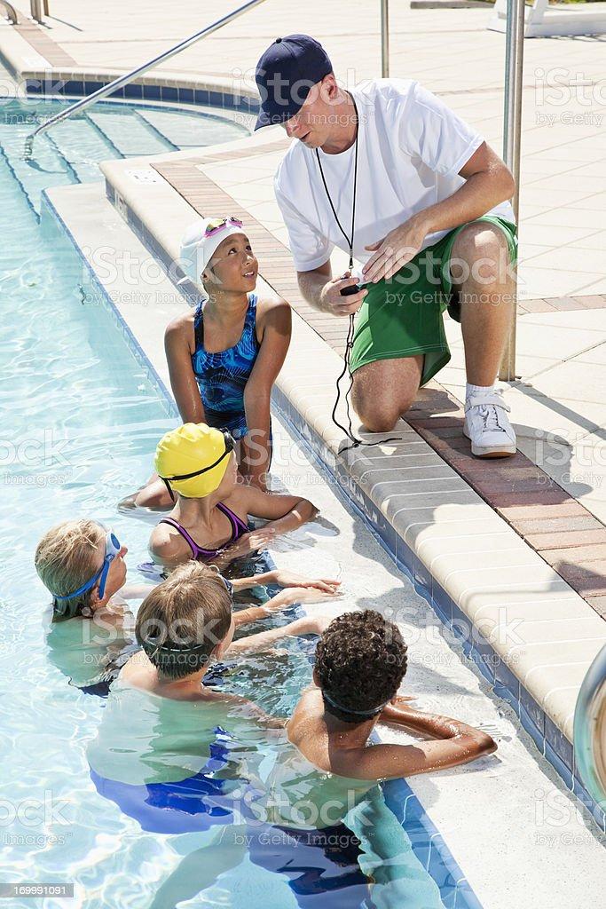 Coach talking to swim team stock photo