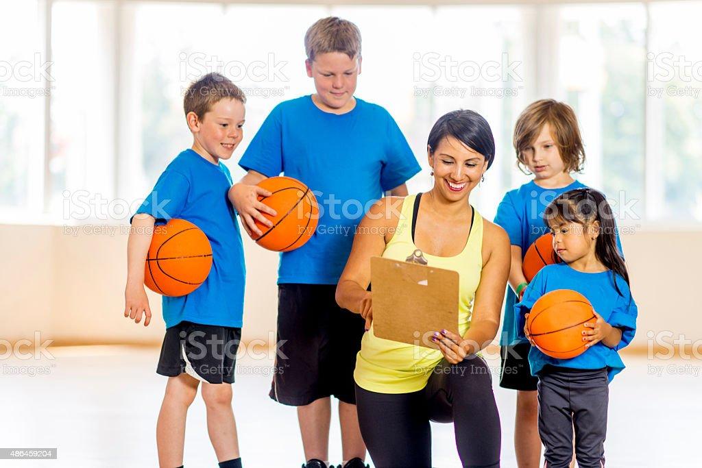 Coach Teaching a Basketball Play stock photo