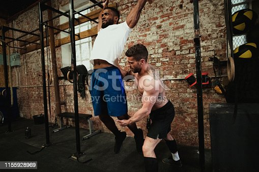 1069872470 istock photo Coach Teaching Muscle-Ups 1155928969