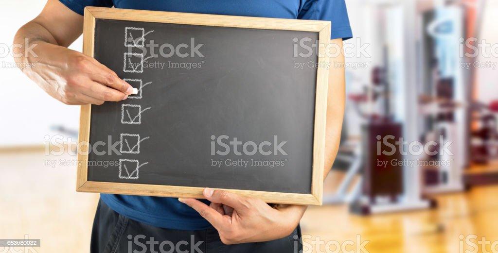 Coach with a blackboard stock photo