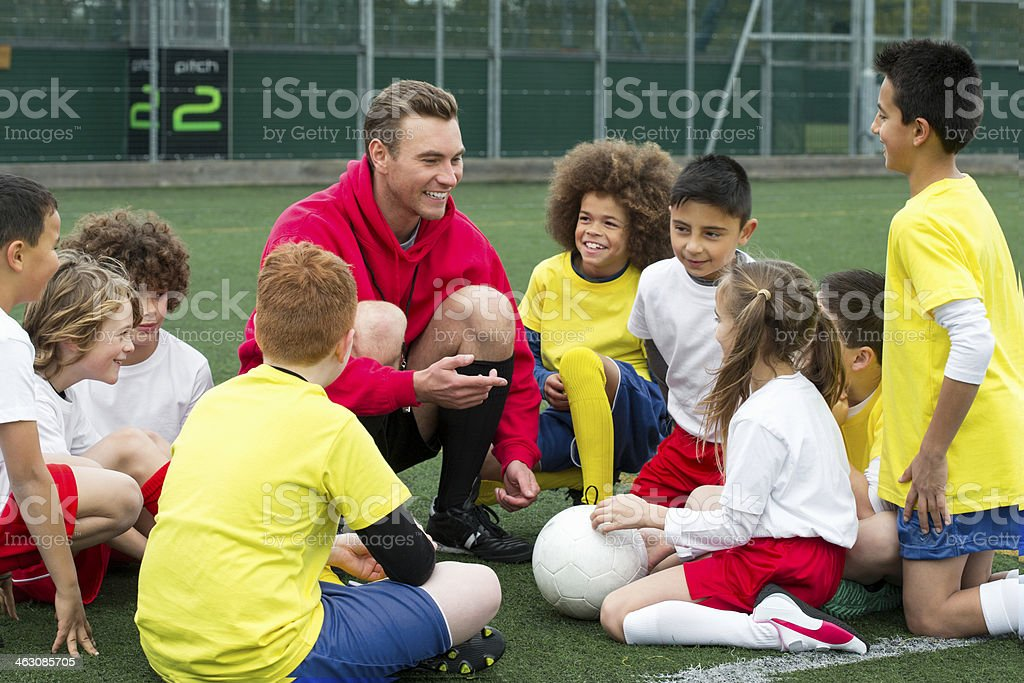 Coach with Young Players stock photo