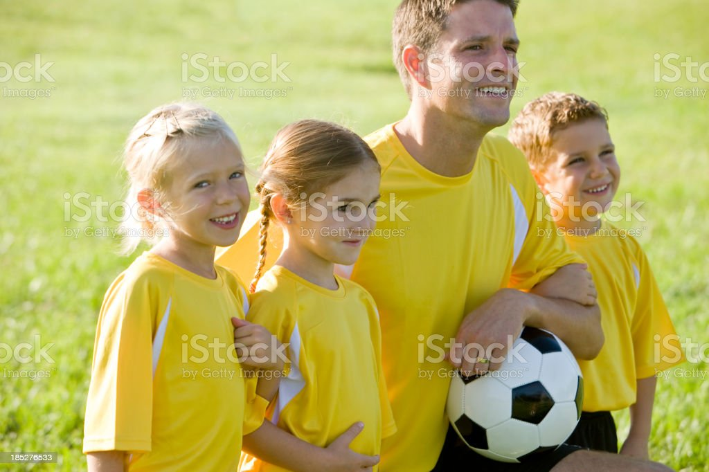 Coach with young team of soccer players stock photo
