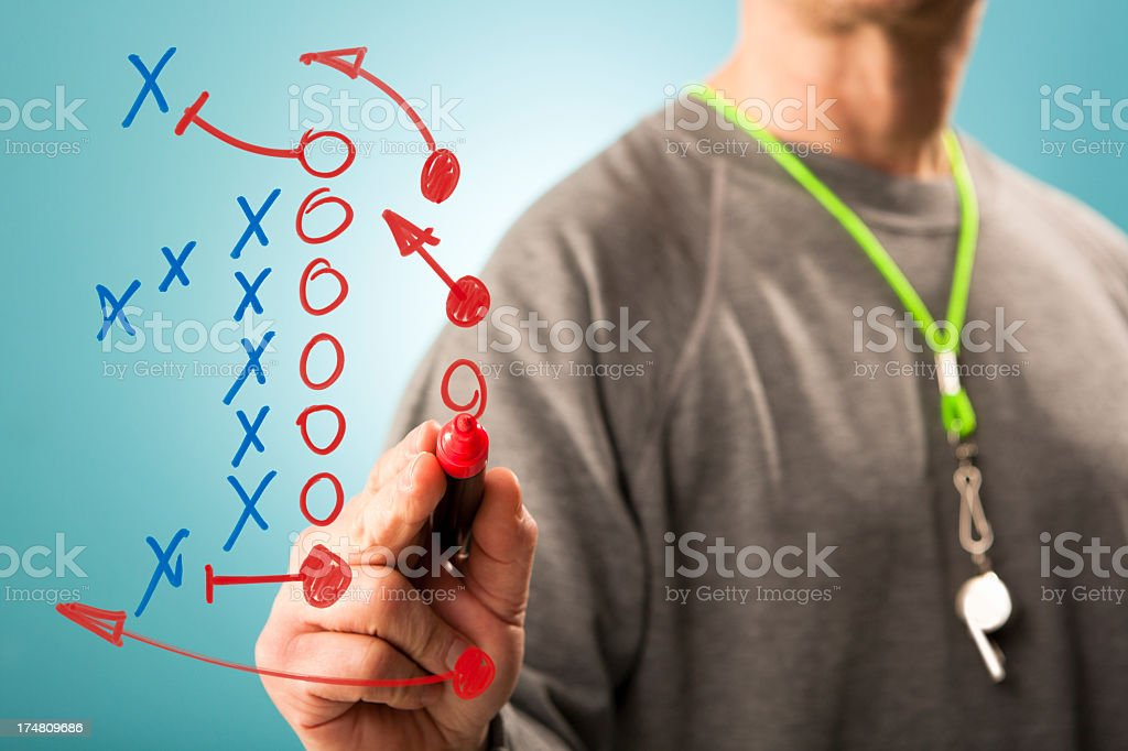 Coach writes down tactics stock photo