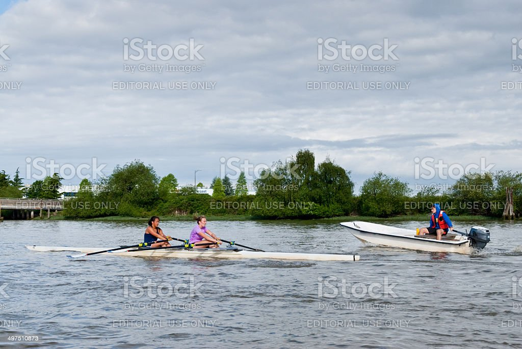 Coaching a Double Scull on the Fraser River royalty-free stock photo