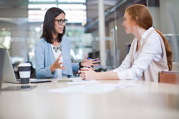 Coaching and advise, two business woman working together. - foto stock