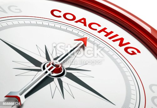 istock Coaching Concept: Arrow of A Compass Pointing Coaching Text 858868124