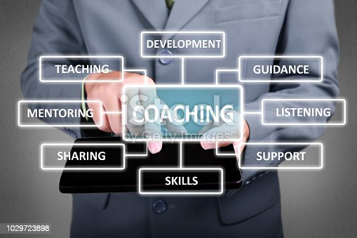 Business Concept. Businessman click coaching button on his tablet. Coaching strategy scheme diagram. Text typography design