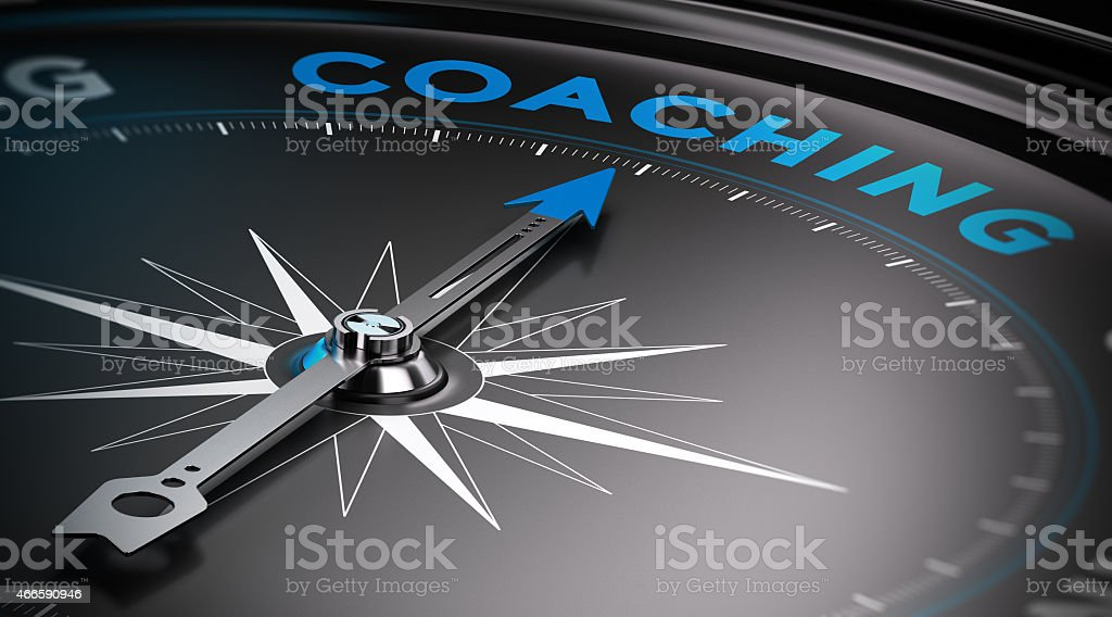Coaching Attain personal goals, personal trainer concept. Conceptual Compass with needle pointing to the word coaching. 2015 Stock Photo