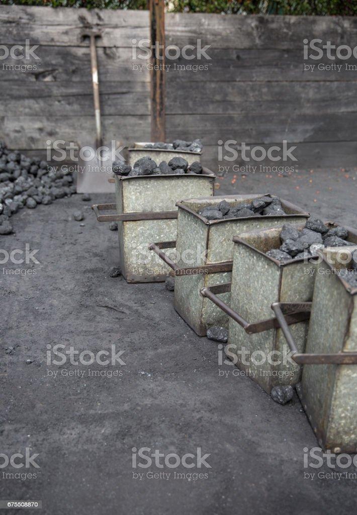 Coal and a shovel in a coal stocking yard photo libre de droits