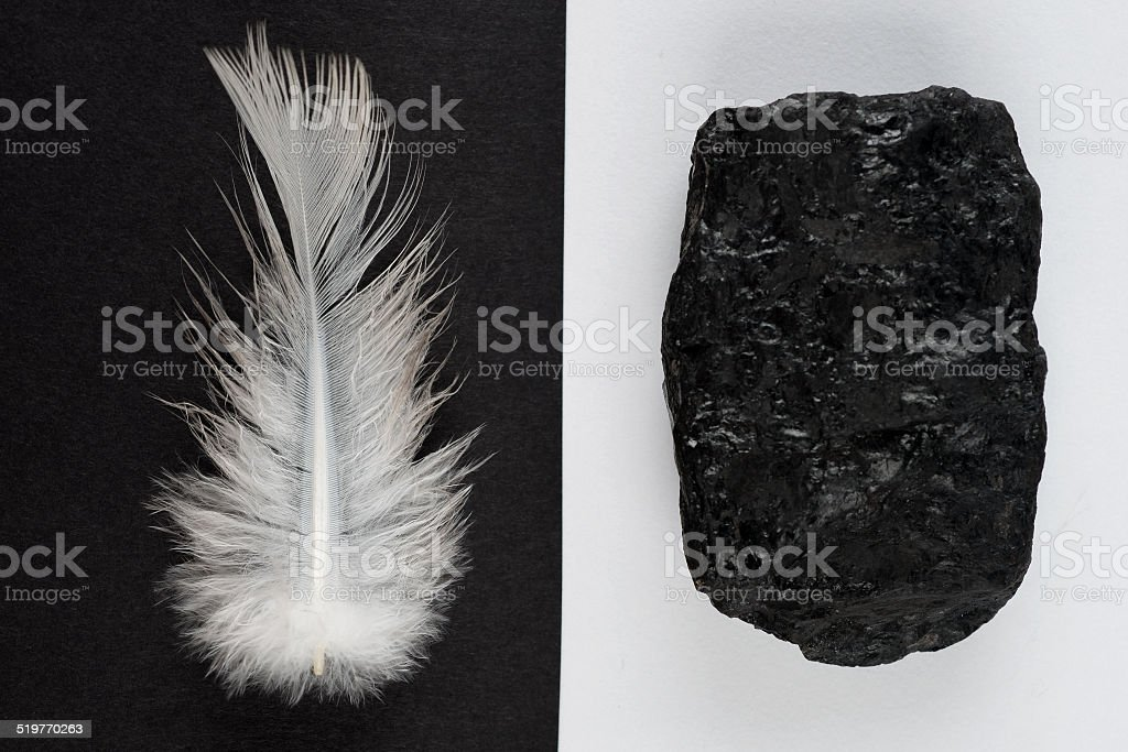 Coal and Feather Contrast stock photo