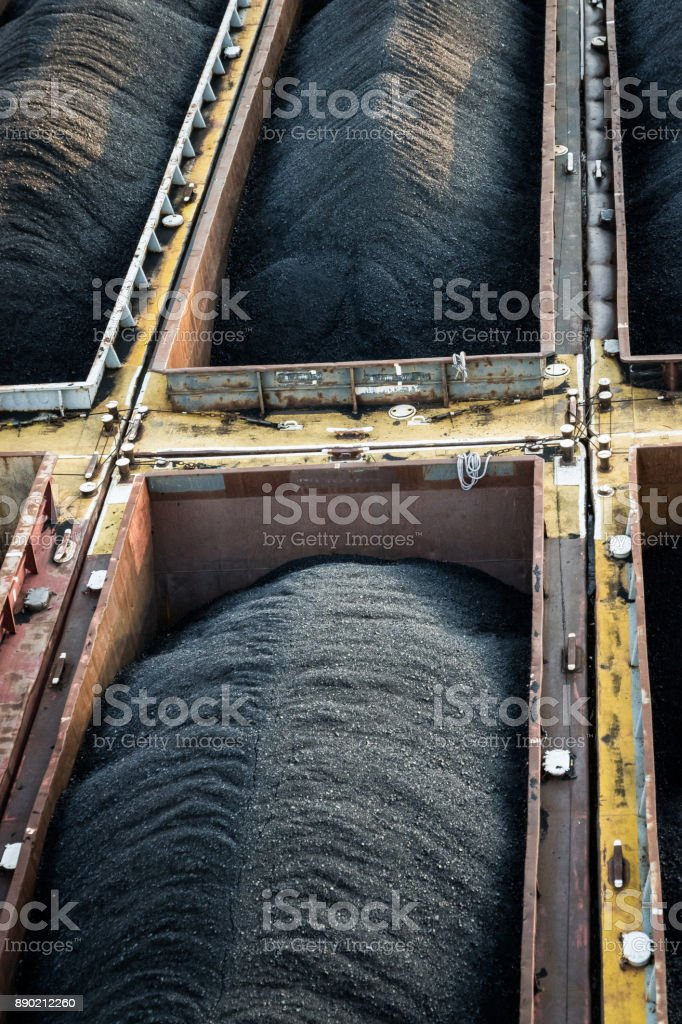 Coal being transported in barges on a river stock photo