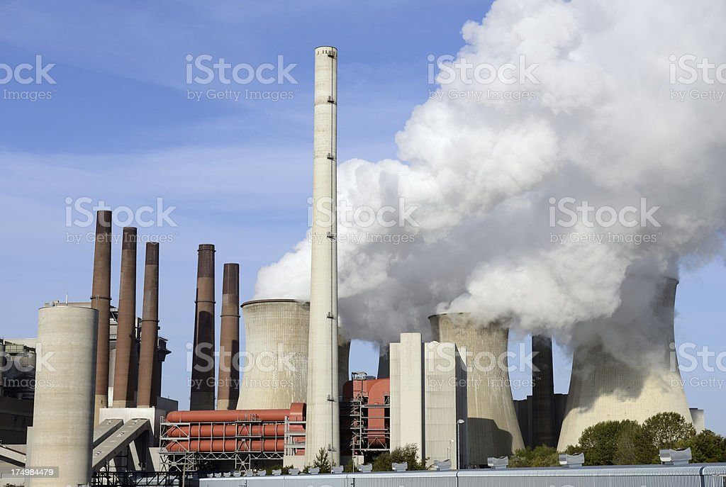 Coal burning power plant with pollution royalty-free stock photo