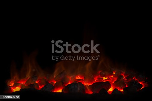 istock Coal fire with black background 673869778