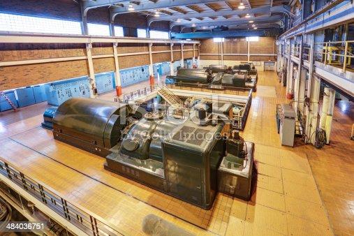 The interior of a 100 Megawatt coal fired power station showing three steam turbine generators.