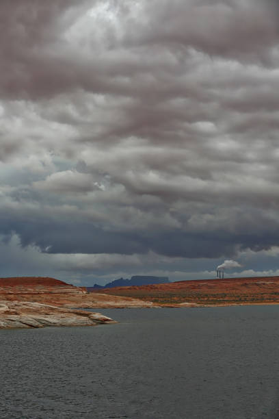 Coal fired power plant smokestacks. Lake Powell. Arizona. Coal fired power plant smokestacks and ominous sky. Lake Powell, Arizona navajo sandstone formations stock pictures, royalty-free photos & images