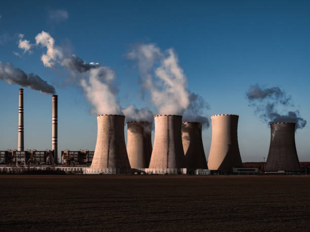 coal fired power station silhouette at sunset, Pocerady, Czech republic stock photo