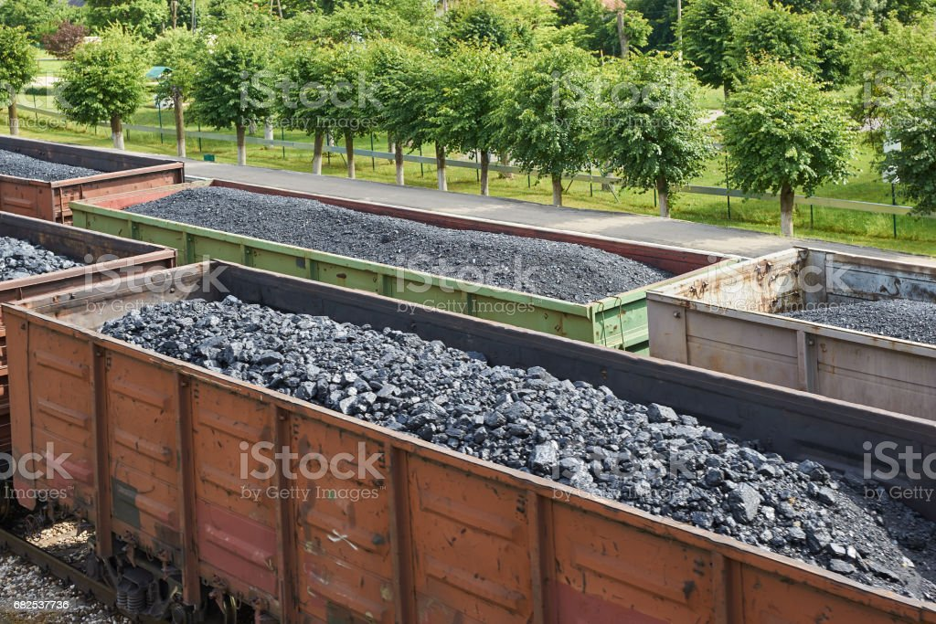 Coal freight trains at the railway station stock photo