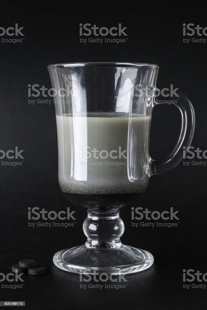 Coal latte. Black cappuccino. Black coffee with activated carbon. stock photo