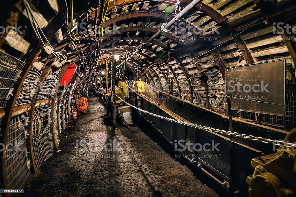 Coal mine underground corridor with conveyor system stock photo