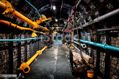 Coal mine underground corridor with steel support system and industrial equipments, Bochum, Germany