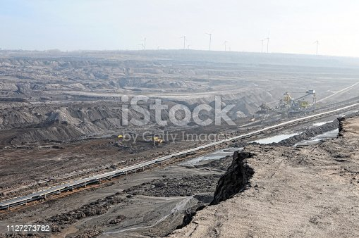 istock Coal mine with bucket wheel excavator. air pollution. 1127273782